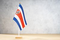 Costa Rica table flag on white textured wall. Copy space for text, designs or drawings
