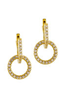 Golden sparkling earrings with protection symbol isolated on a white background.
