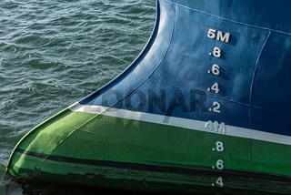 Bulb bow of a blue fishing ship..