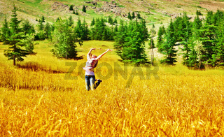 Girl jumping on wheat field