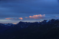 Bright lit clouds over mountains near the Grimsel mountain pass.