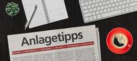 Newspaper on a desk -  Investment advice in german - Anlagetipps