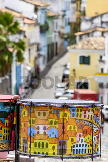 Decorated drums with the streets and slopes of the Pelourinho district