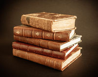 Stack of old books on dark background