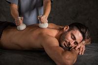 Man get herbal massage