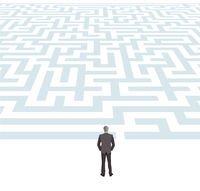 Businessman in front of a maze