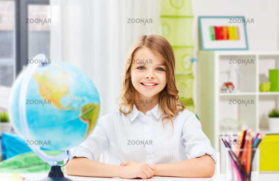happy smiling student girl with globe at home