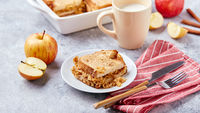 Bread pudding breakfast casserole made from wheat bread, eggs, milk and grated apples