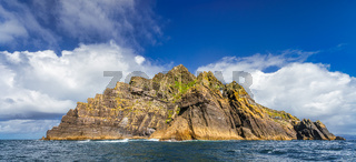Skellig Lighthouse sticks out from behind off the rock on Skellig Michael island
