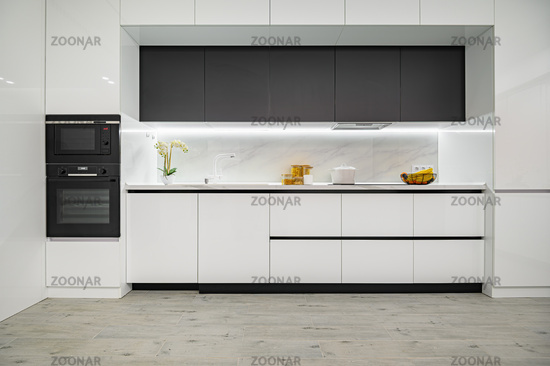 Luxury white and black modern marble kitchen, front view