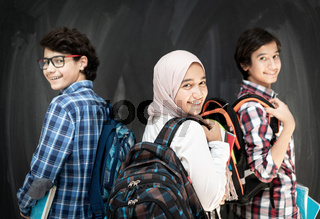 Group of multy ethnic kids in classroom