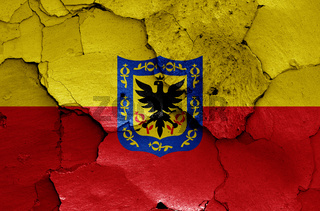 flag of Bogota painted on cracked wall