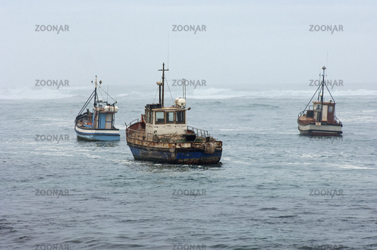 Fishing vessels at sea in the Atlantic Ocean