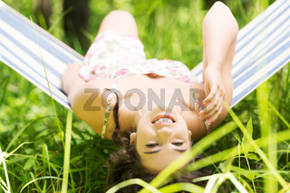 Young woman lying in a hammock
