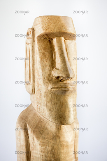 Traditional statue of a moai from Easter Island on white background