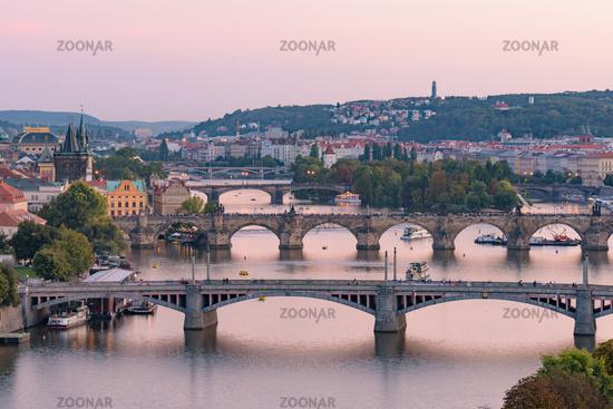 View of three bridges over the River Vltava at sunset time in Prague, Czech Republic