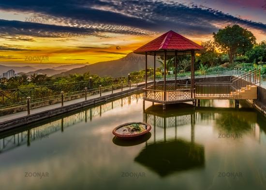 Pavilion on the pond at sunset