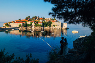 Silhouettes of couples near Sveti Stefan