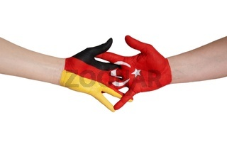 a close handshake between germany and turkey symbolizing partnership