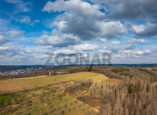 Aerial view over forests and meadows of Westerwald, Altenkirchen, Germany