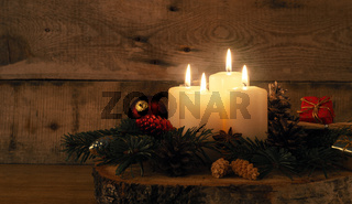 Fourth Advent candle burning, traditional Christmas decoration