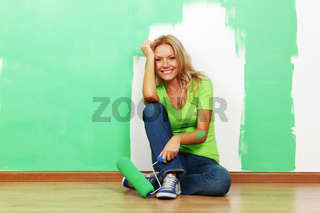 woman paints the wall brush isolated