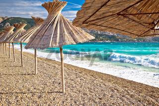 Idyllic beach in Baska sun shades view, Island of Krk, Croatia