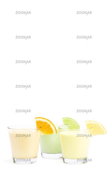 three cold citrus fruit milkshakes
