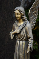 Cemetery angel made of bronze with palm branch