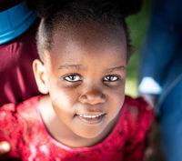 Cute little black African girl close up portrait