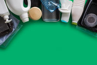 Processing plastic concept. Plastic containers on the green