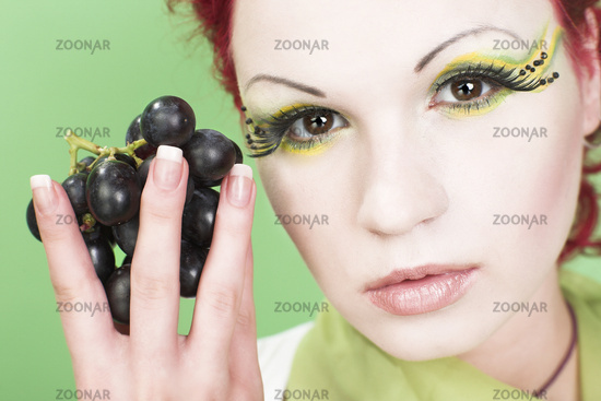 colorful portrait of young woman with grapes