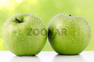 Two fresh green apples