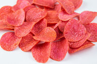 Red chips with hot pepper taste on a white background. Beer snack.