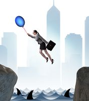 Businesswoman flying on balloon in business concept