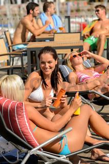 Young woman sunbathing on deckchair summer