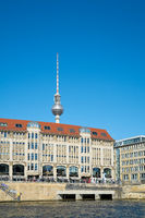 City view of Berlin with television tower in background seen from Spree river