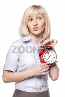 A beautiful young woman with alarm clock isolated on white