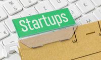 A brown file folder labeled Startups