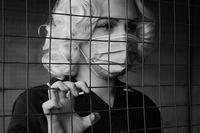sad blond prisoner