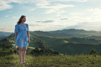 Woman in blue dress in Altai mountain,