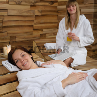 Smiling woman at spa lying down