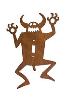 Traditional american ethnic sculpture of a devil. White background