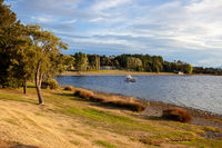TE ANAU, FIORDLAND, NEW ZEALAND - FEBRUARY 17 : Golden evening light on Lake Te Anau, Fiordland, New Zealand on February 17, 2012