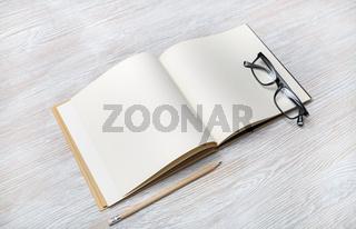 Book, glasses, pencil