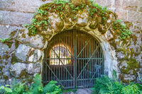 Iron gate with archway into a fortress
