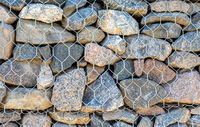 Stone wall with metal grid as background
