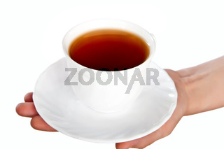 White cup with saucer in hand