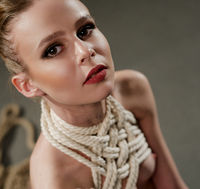 Woman tied up with rope high angle portrait