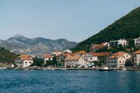 The coastline of the city of Lepetane in Montenegro, near the ferry crossing through Kotor Bay.